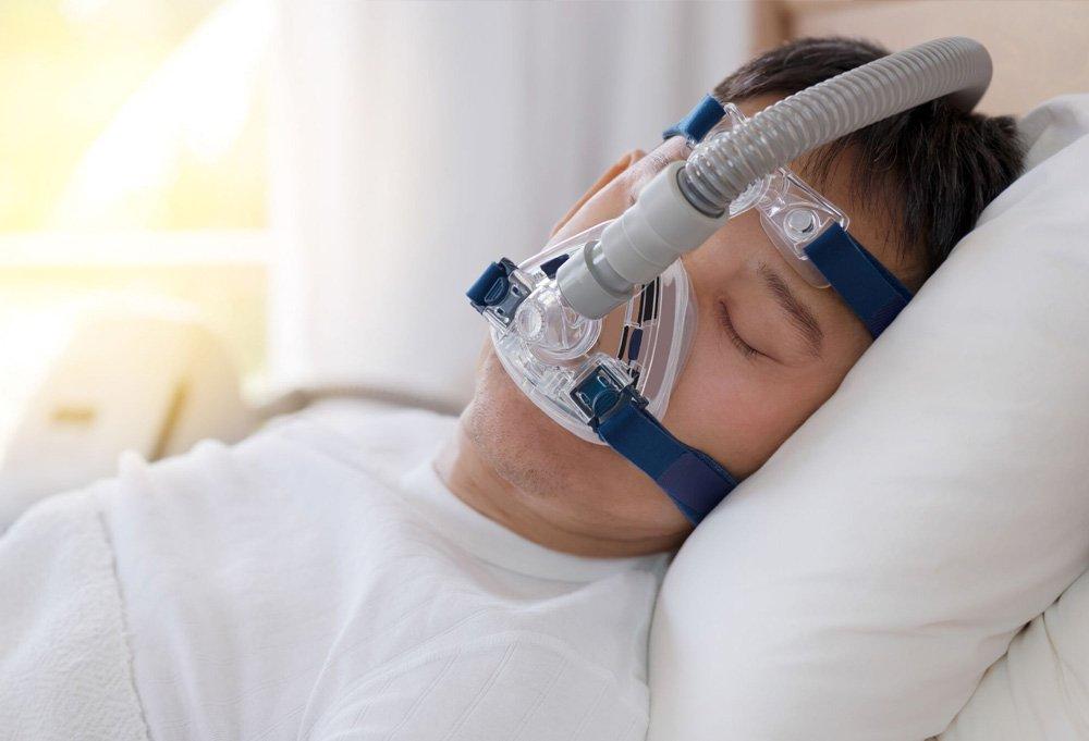 sleep apnea patient sleeping with a CPAP machine