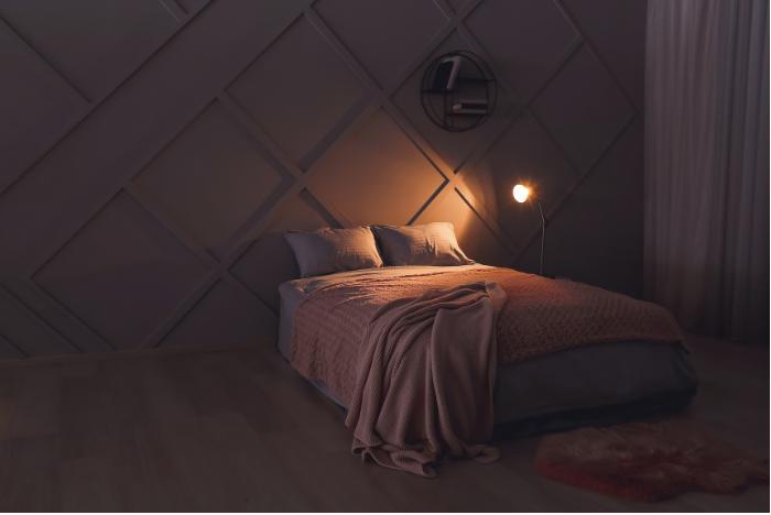 dark bedroom with lamp light