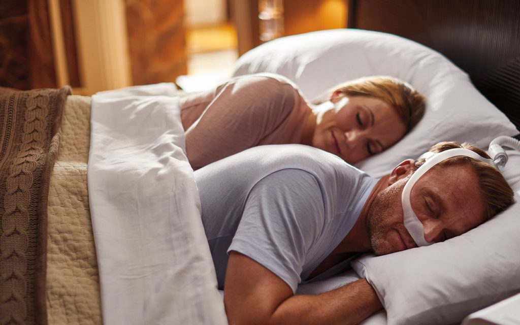 man sleeping on his side with cpap machine